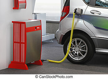 EV charging station - Electric vehicle with plugged cable in...