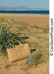 Summer scene - Handbag amidst sunny beach dunes, a summer...