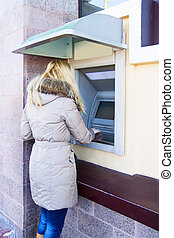 Young Woman using Bank ATM