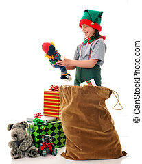 Christmas Elf Inscpection - A Christmas elf inspecting a...