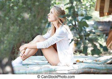 Beauty in nature - Beautiful lady in white shirt outdoors...