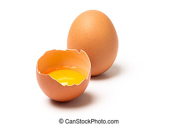 Two brown eggs isolated - Two raw brown eggs, one broken,...
