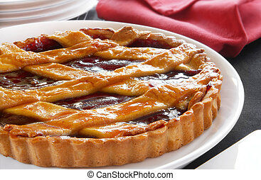 Fruit Flan - Glazed fruit flan with lattice top, ready for...