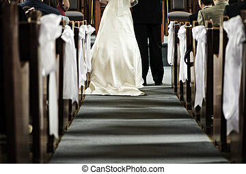 Wedding in church - Bride and groom getting married in...