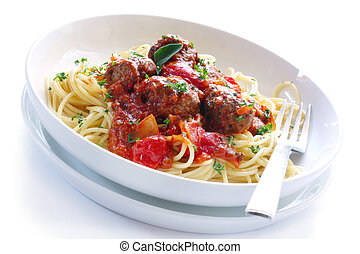 Spaghetti and Meatballs - White bowl of spaghetti and...