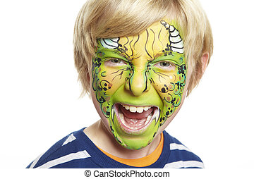 Young boy with face painting monster smiling on white...