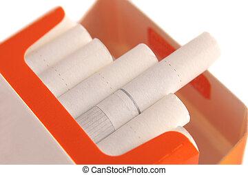 cigarette box 2 - Close-up orange cigarette box on a white...