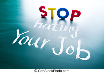Stop hating your job concept, colorful words on blackboard