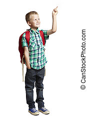School boy pointing with backpack - 8 year old school boy...