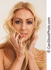 Beautiful blond with fluttering hair - Beautiful blond woman...