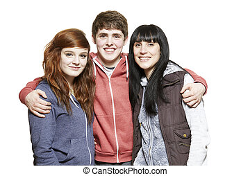 Teenage siblings smiling on white background