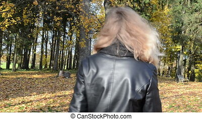woman autumn park bench