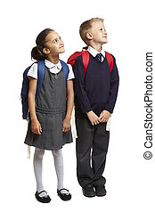 School boy and girl looking up - 8 year old school boy and...