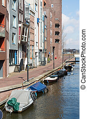 New residential area from Amsterdam along a canal with small boats