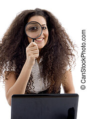 latin american female holding magnifier