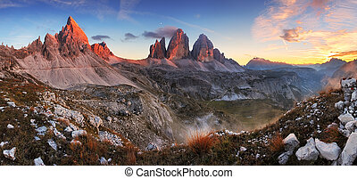 Dolomites mountain panorama in Italy at sunset - Tre Cime di...