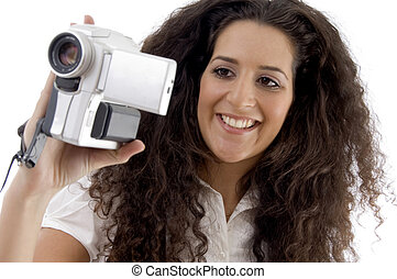 young photographer making video with handy cam on an...