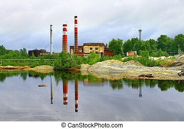 Smokestacks - Reflection of two smokestacks in a lake