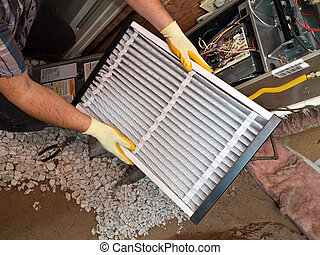 Hispanic air conditioning repair man performing maintenance