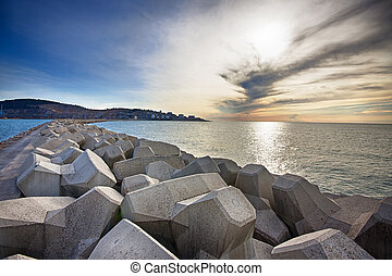 Breakwater with concrete blocks for protection of coast,...