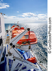 Lifeboat - Red lifeboats on a cruise ship