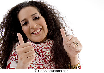 young woman showing thumb up with both hands on an isolated...