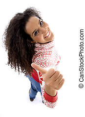 high angle view of smiling young woman showing thumb up with...