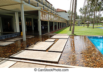 The swimming pool and building of luxury hotel, Bentota, Sri Lanka