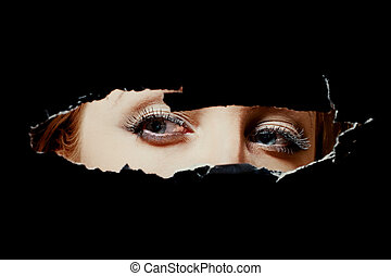 Eyes of a young woman peeping through hole - Eyes of a young...