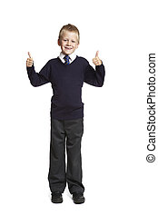 School boy with thumbs up - 8 year old school boy with...