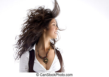 fashionable teen with her hair fluttering in air