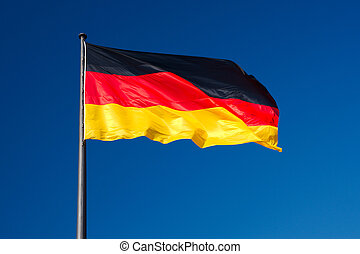 German flag against sky - National flag of Germany against...