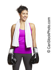 Young woman in sports outfit wearing boxing gloves and towel...