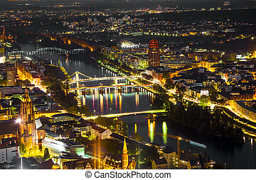 Frankfurt am Main at night with view to bridges spanning the Mai