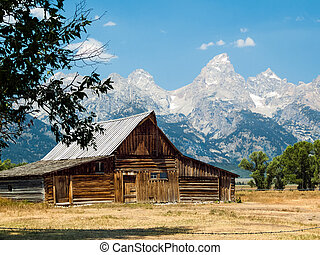 Rustic Barn and Tetons - A rustic old barn on Mormon Row in...