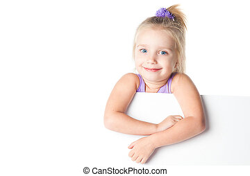 surprised little girl looking over empty board isolated