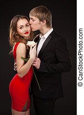beautiful elegant love couple wearing suit and red dress...