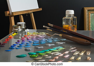 Artists paint palette and workspace - Artists studio...
