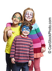 Young boy and two girls with face painting of cat, butterfly...