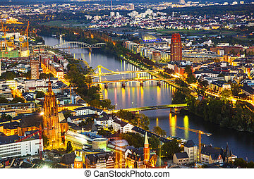 aerial of Frankfurt with river Main by night