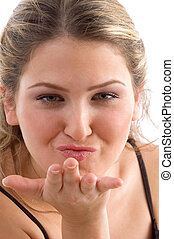 pretty woman giving flying kiss on an isolated background