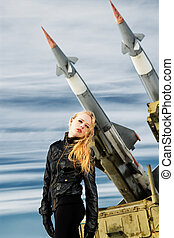 girl and ballistic missile - brutal girl standing on a...