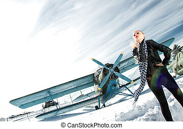 girl and plane winter - sexy young girl next to the pilot...