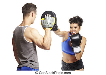 Young man and woman boxing sparring in sports outfits on...