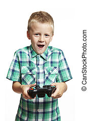 Boy playing games console - 8 year old boy playing games...