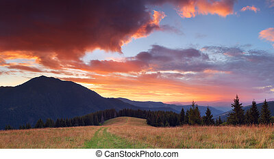 Beautiful sunset in the mountains - Panorama of mountains...