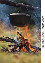 Cauldron on fire - Cooking in the mountains. Cauldron on...