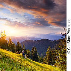 Last rays of the sun in the mountains - Evening in the...