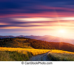 Sunset in the mountains and the road - Beautiful sunset in...