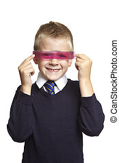 8 year old school boy with pink ruler on white background -...